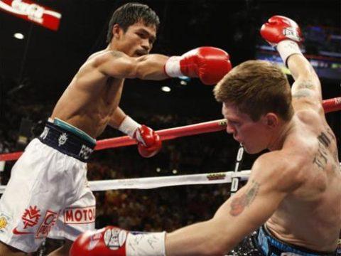 Án phạt mới nhất đồng nghĩa với việc trận thua knock-out trước Pacquiao là trận đấu cuối cùng trong sự nghiệp của Hatton (phải). Ảnh: New of the World.