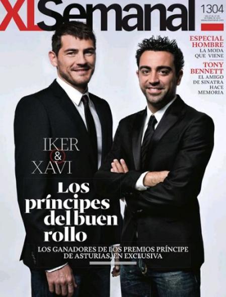 Thủ thành Casillas và Xavi.
